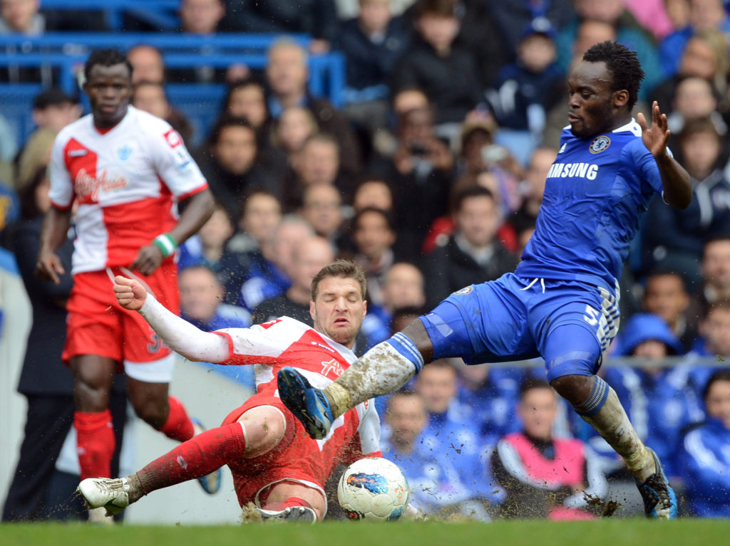 """Chelsea's Ghanaian midfielder Michael Essien (R) competes for the ball against Queens Park Rangers' Akos Buzsaky during the English Premier League football match between Chelsea and QPR at Stamford Bridge in London on April 29, 2012. Chelsea's Fernando Torres scored a hat-trick in the match and Chelsea won the game 6-1. AFP PHOTO / ADRIAN DENNIS  RESTRICTED TO EDITORIAL USE. No use with unauthorized audio, video, data, fixture lists, club/league logos or """"live"""" services. Online in-match use limited to 45 images, no video emulation. No use in betting, games or single club/league/player publications. / AFP PHOTO / ADRIAN DENNIS"""