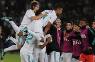 Real Madrid players celebrate after scoring a goal during the Club World Cup UAE 2017 final football match between Gremio FBPA and Real Madrid at the Zayed Sports City Stadium in Abu Dhabi on December 16, 2017. / AFP PHOTO / KARIM SAHIB
