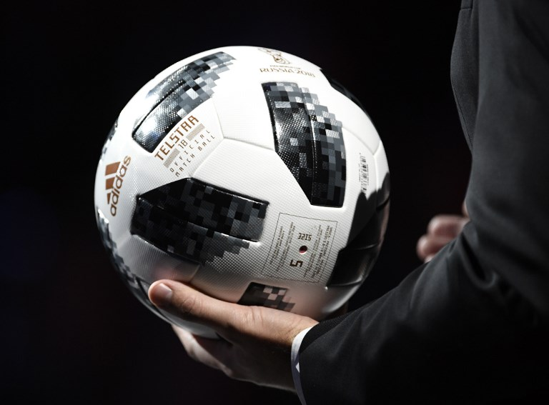 The official ball Telstar 18 is presented during the 2018 FIFA World Cup football tournament final draw at the State Kremlin Palace in Moscow on December 1, 2017. The 2018 FIFA World Cup will be held between June 14 and July 15, 2018 in 11 Russian cities. / AFP PHOTO / Alexander NEMENOV