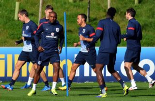 England footballer Jermaine Defoe (3rd L) and team-mates attend a training session at the St George's Park training complex, near Burton-upon-Trent in central England, on October 8, 2013. England face Montenegro at Wembley in a 2014 World Cup qualifier on October 11, 2013.  AFP PHOTO/Paul Ellis NOT FOR MARKETING OR ADVERTISING USE / RESTRICTED TO EDITORIAL USE / AFP PHOTO / PAUL ELLIS