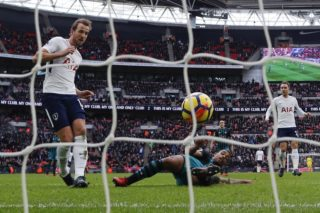 Tottenham Hotspur's English striker Harry Kane (L) scores his team's and his second goal of the English Premier League football match between Tottenham Hotspur and Southampton at Wembley Stadium in London, on December 26, 2017. Harry Kane beat Alan Shearer's 36 goal record for the most Premier League goals scored in a calendar year, after scoring during Tottenham's game against Southampton. / AFP PHOTO / Adrian DENNIS / RESTRICTED TO EDITORIAL USE. No use with unauthorized audio, video, data, fixture lists, club/league logos or 'live' services. Online in-match use limited to 75 images, no video emulation. No use in betting, games or single club/league/player publications.  /