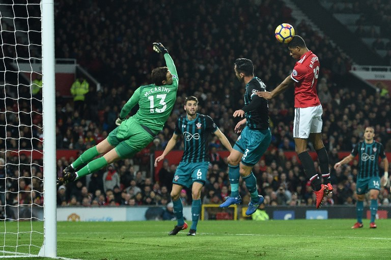 Manchester United's English striker Marcus Rashford (2nd R) fails to score with this attempt during the English Premier League football match between Manchester United and Southampton at Old Trafford in Manchester, north west England, on December 30, 2017. / AFP PHOTO / Oli SCARFF / RESTRICTED TO EDITORIAL USE. No use with unauthorized audio, video, data, fixture lists, club/league logos or 'live' services. Online in-match use limited to 75 images, no video emulation. No use in betting, games or single club/league/player publications.  /