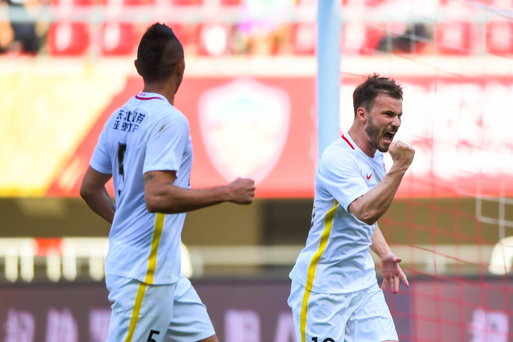 Hungarian football player Szabolcs Huszti, right, of Changchun Yatai, celebrates with his teammate after scoring a goal against Tianjin Quanjian in their 8th round match during the 2017 Chinese Football Association Super League (CSL) in Tianjin, China, 6 May 2017.  Changchun Yatai defeated Tianjin Quanjian 3-1.