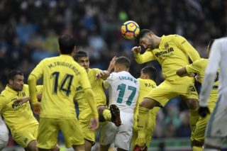 Villarreal's Spanish defender Alvaro Gonzalez heads the ball during the Spanish league football match between Real Madrid and Villarreal at the Santiago Bernabeu Stadium in Madrid on January 13, 2018. / AFP PHOTO / GABRIEL BOUYS