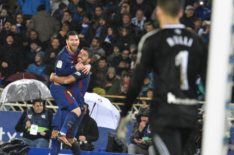 Lionel Messi of Barcelona celebrates with teammates after scoring during the Spanish league football match between Real Sociedad and Barcelona at the Anoeta Stadium on 14 January 2018 in San Sebastian, Spain (Photo by Jose Ignacio Unanue/NurPhoto)