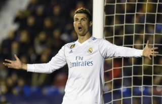 Real Madrid's Portuguese forward Cristiano Ronaldo reacts during the Spanish league football match between Levante UD and Real Madrid CF at the Ciutat de Valencia stadium in Valencia on February 03, 2018. / AFP PHOTO / JOSE JORDAN