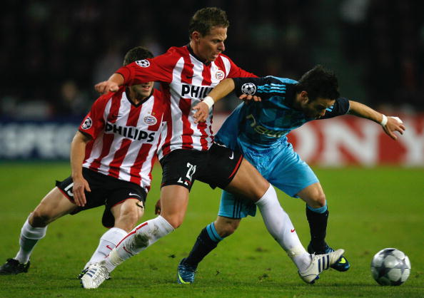 EINDHOVEN, NETHERLANDS - OCTOBER 22:  Balazs Dsudzsak of PSV Eindhoven battles for the ball with Mathieu Valbuena of Marseille during the UEFA Champions League Group D match between PSV Eindhoven and Marseille at the Philips Stadium on October 22, 2008 in Eindhoven, Netherlands.  (Photo by Paul Gilham/Getty Images)