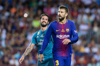 BARCELONA, SPAIN - AUGUST 13: Isco Alarcon of Real Madrid (L) and Gerard Pique Bernabeu of FC Barcelona (R) during the Supercopa de Espana Final 1st Leg match between FC Barcelona and Real Madrid at Camp Nou on August 13, 2017 in Barcelona, Spain. (Photo by Marcio Rodrigo Machado/Power Sport Images/Getty Images,)