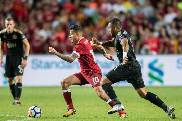 HONG KONG, HONG KONG - JULY 22: Liverpool FC midfielder Philippe Coutinho (L) competes for the ball with Leicester City FC defender Danny Simpson during the Premier League Asia Trophy match between Liverpool FC and Leicester City FC at Hong Kong Stadium on July 22 2017, in Hong Kong, Hong Kong. (Photo by Victor Fraile/Getty Images)