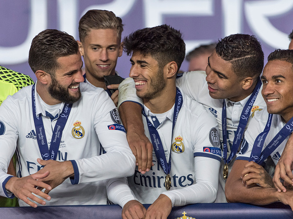 TRONDHEIM, NORWAY - AUGUST 09: Real Madrid players Nacho, Marcos Llorente, Marco Asensio, Casemiro, Danilo celebrate with team mates and the trophy after theUEFA Super Cup match between Real Madrid and Sevilla at the Lerkendal Stadion on August 9, 2016 in Trondheim, Norway. (Photo by Trond Tandberg/Getty Images)
