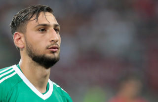 MILAN, ITALY - AUGUST 03:  Gianluigi Donnarumma of AC Milan looks on during the UEFA Europa League Third Qualifying Round Second Leg match between AC Milan and CSU Craiova at Stadio Giuseppe Meazza on August 3, 2017 in Milan, Italy.  (Photo by Emilio Andreoli/Getty Images)