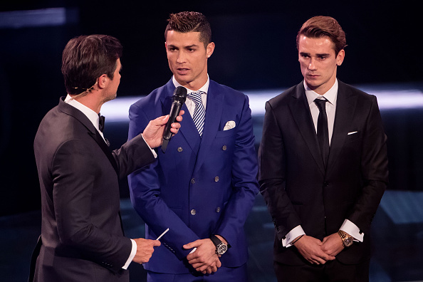 ZURICH, SWITZERLAND - JANUARY 09: Presenter Marco Schreyl (L) speaks with The Best FIFA Men's Player Award nominees Cristiano Ronaldo of Portugal and Real Madrid (C) and Antoine Griezmann of France and Atletico Madrid (R) during The Best FIFA Football Awards 2016 on January 9, 2017 in Zurich, Switzerland. (Photo by Philipp Schmidli/Getty Images)