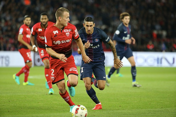 PARIS, FRANCE - SEPTEMBER 20:  Angel Di Maria of Paris Saint-Germain in action with Adam Lang of Dijon FCO during the French Ligue 1 match between Paris Saint-Germain and Dijon FCO at Parc des Princes on September 20, 2016 in Paris, France.  (Photo by Xavier Laine/Getty Images)