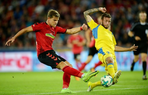 Florian Niederlechner (l) of Freiburg and Miha Blazic (r) of Domzal vie for the ball during the Europa League qualifier between SC Freiburg and NK Domzale at the Schwarzwald-Stadion in Freiburg im Breisgau, Germany, 27 July 2017. Photo: Patrick Seeger/dpa