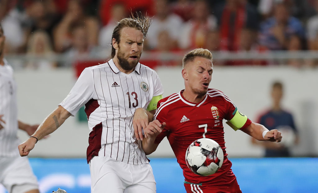 BUDAPEST, HUNGARY - AUGUST 31: Balazs Dzsudzsak (R) of Hungary and Kaspars Gorkss (L) of Latvia in action during the FIFA 2018 World Cup Qualifier match between Hungary and Latvia at Groupama Arena on August 31, 2017 in Budapest, Hungary. (Photo by Laszlo Szirtesi/Getty Images)