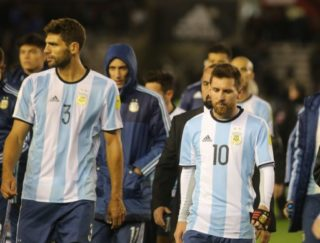 BUENOS AIRES, ARGENTINA - SEPTEMBER 6: Lionel Messi (R) retires from the field with Federico Fazio (L) of Argentina during the 2018 FIFA Argentina football match between Argentina and Venezuela at Monumental Stadium on September 05 of 2017 in Buenos Aires, Mariano Sanchez / Anadolu Agency
