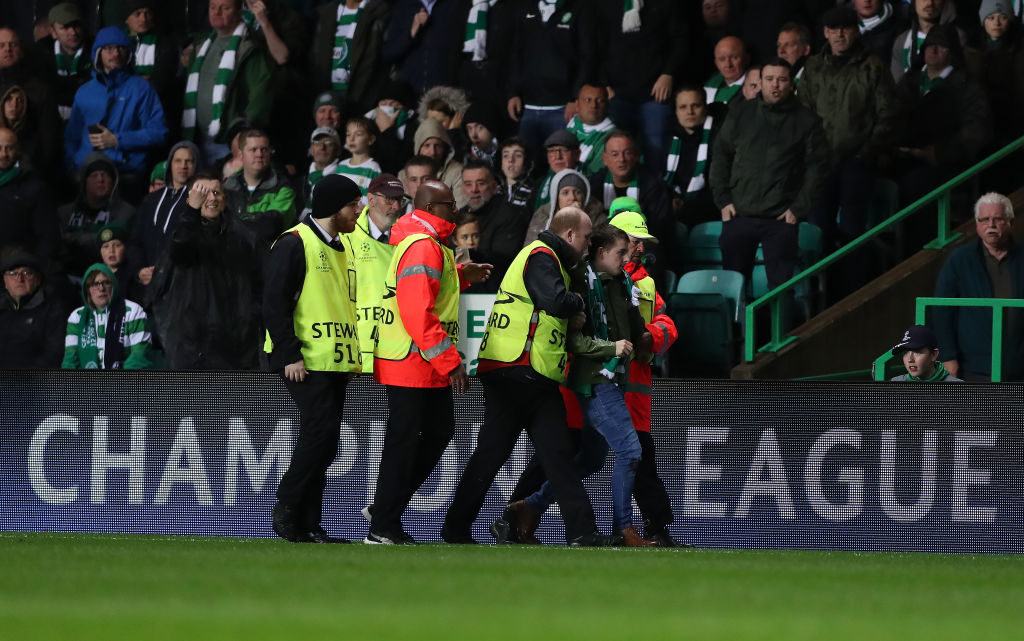 GLASGOW, SCOTLAND - SEPTEMBER 12: A fan is apprehended by security staff after he runs on to the pitch during the UEFA Champions League Group B match Between Celtic and Paris Saint-Germain at Celtic Park on September 12, 2017 in Glasgow, Scotland. (Photo by Ian MacNicol/Getty Images)