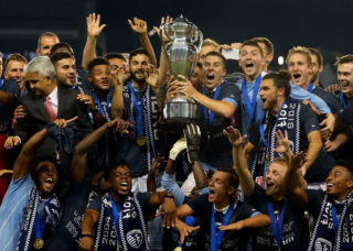 KANSAS CITY, KS - SEPTEMBER 20:  Matt Besler #5 and Sporting Kansas City celebrate with the trophy after they defeated New York Red Bulls 2-1 to win  the 2017 U.S Open Cup Final at Children's Mercy Park on September 20, 2017 in Kansas City, Kansas.  (Photo by Jamie Squire/Getty Images)