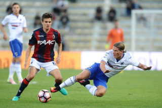 BOLOGNA, ITALY - SEPTEMBER 21:  Adam Nagy # 16 of Bologna FC ( L ) competes the ball with Dennis Praet # 18 of UC Sampdoria  during the Serie A match between Bologna FC and UC Sampdoria at Stadio Renato Dall'Ara on September 21, 2016 in Bologna, Italy.  (Photo by Mario Carlini / Iguana Press/Getty Images)