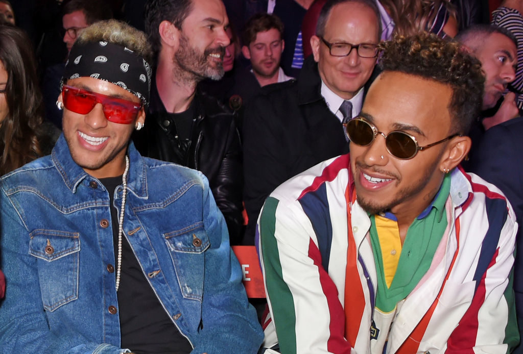 LONDON, ENGLAND - SEPTEMBER 19:  Neymar (L) and Lewis Hamilton attend the Tommy Hilfiger TOMMYNOW Fall 2017 Show during London Fashion Week September 2017 at The Roundhouse on September 19, 2017 in London, England.  (Photo by David M. Benett/Dave Benett/Getty Images for Tommy Hilfiger )