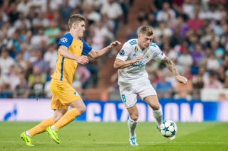 MADRID, SPAIN - SEPTEMBER 13: Toni Kroos (r) of Real Madrid battles for the ball with Roland Sallai of APOEL FC during the UEFA Champions League 2017-18 match between Real Madrid and APOEL FC at Estadio Santiago Bernabeu on 13 September 2017 in Madrid, Spain. (Photo by Power Sport Images/Getty Images)