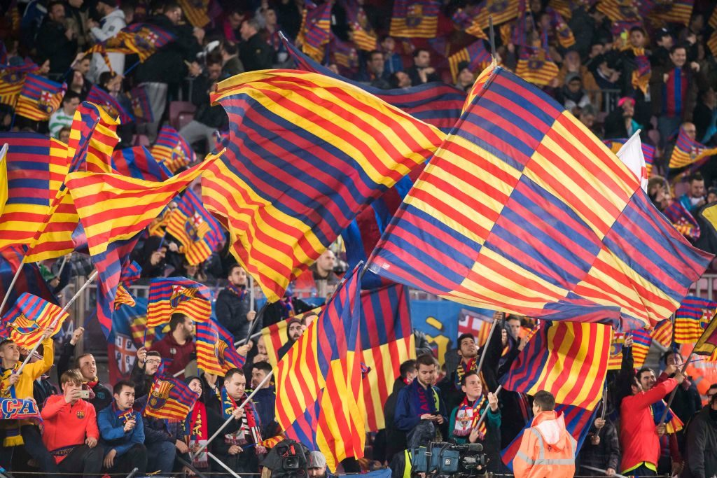 BARCELONA, SPAIN - FEBRUARY 07: Fans of FC Barcelona wave flags to show their supports prior to the Copa del Rey 2016-17 Semi-final match between FC Barcelona and Atletico de Madrid at the Camp Nou on 07 February 2017 in Barcelona, Spain. (Photo by Power Sport Images/Getty Images)
