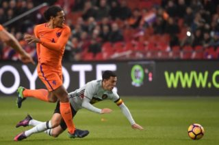 Netherland's Virgil van Dijk and Belgium's Eden Hazard fight for the ball during a friendly game of Belgian national soccer team Red Devils against the Netherlands, on Wednesday 09 November 2016, in Amsterdam, Netherlands. 