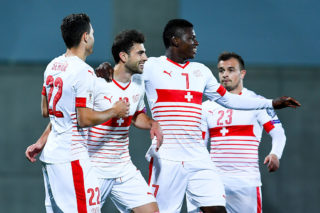 ANDORRA LA VELLA, ANDORRA - OCTOBER 10:  Fabian Schar (L) of Switzerland celebrates with his team mates after scoring his team's first goal from the penalty spot during the FIFA 2018 World Cup Qualifier between Andorra and Switzerland at Estadi Nacional on October 10, 2016 in Andorra la Vella, Andorra.  (Photo by David Ramos/Getty Images)