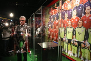 MUNICH, GERMANY - JUNE 04:  Head coach Jupp Heynckes of FC Bayern Muenchen places the UEFA Champions League winners trophy in Bayern Muenchen interactive club museum after a press conference at Allianz Arena on June 4, 2013 in Munich, Germany.  (Photo by Alexander Hassenstein/Bongarts/Getty Images)