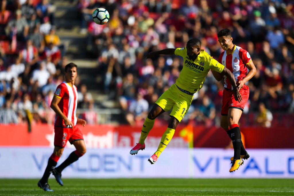 GIRONA, SPAIN - OCTOBER 15:  Cedric Bakambu of Villarreal CF competes for the ball with Juanpe of Girona FC during the La Liga match between Girona and Villarreal at Estadi de Montilivi on October 15, 2017 in Girona, Spain.  (Photo by David Ramos/Getty Images)