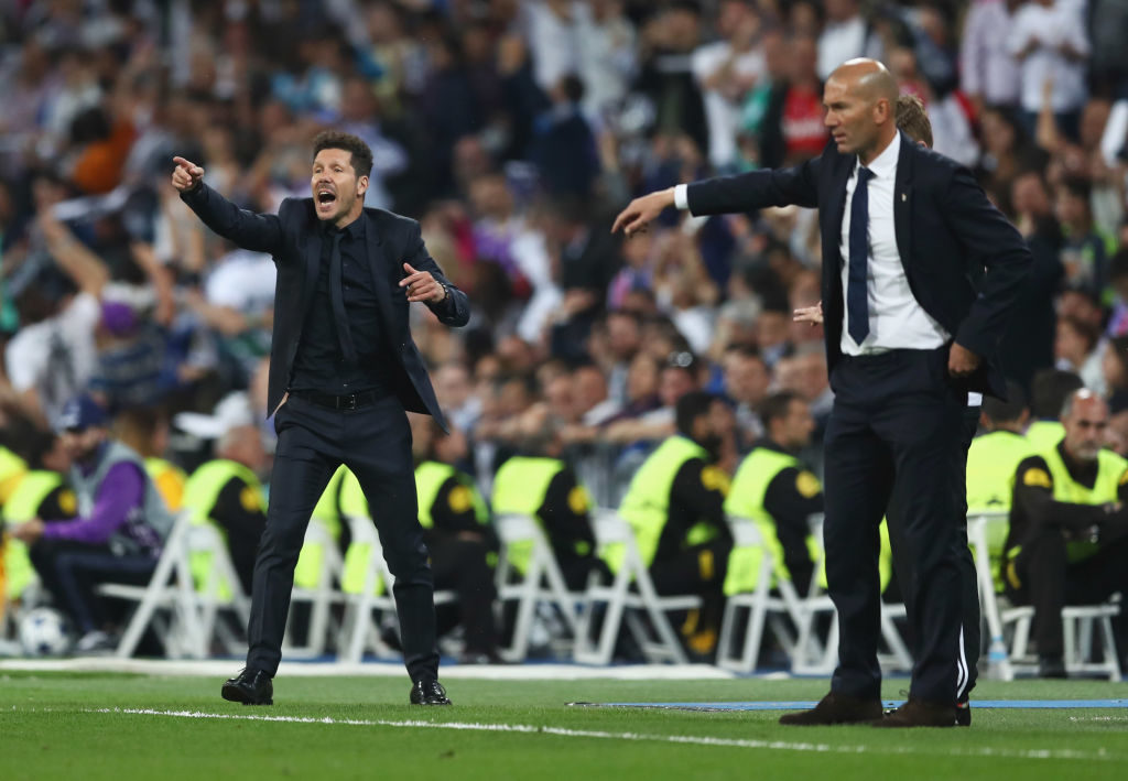 MADRID, SPAIN - MAY 02:  Diego Simeone manager of Atletico Madrid and Zinedine Zidane head coach of Real Madrid signal from the touchline during the UEFA Champions League semi final first leg match between Real Madrid CF and Club Atletico de Madrid at Estadio Santiago Bernabeu on May 2, 2017 in Madrid, Spain.  (Photo by Lars Baron/Getty Images)