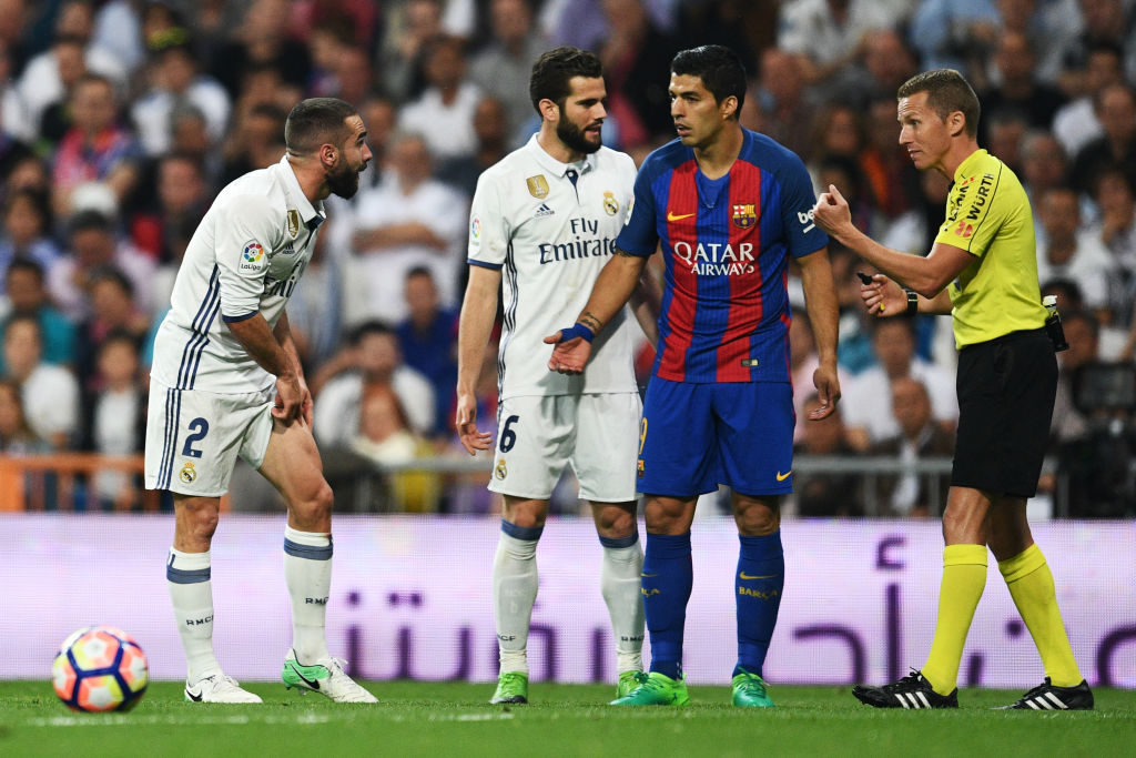 MADRID, SPAIN - APRIL 23:  Daniel Carvajal of Real Madrid appeals to referee Alejandro Jose Hernandez Hernandez after a challenged by Luis Suarez of Barcelona during the La Liga match between Real Madrid CF and FC Barcelona at Estadio Bernabeu on April 23, 2017 in Madrid, Spain.  (Photo by David Ramos/Getty Images)