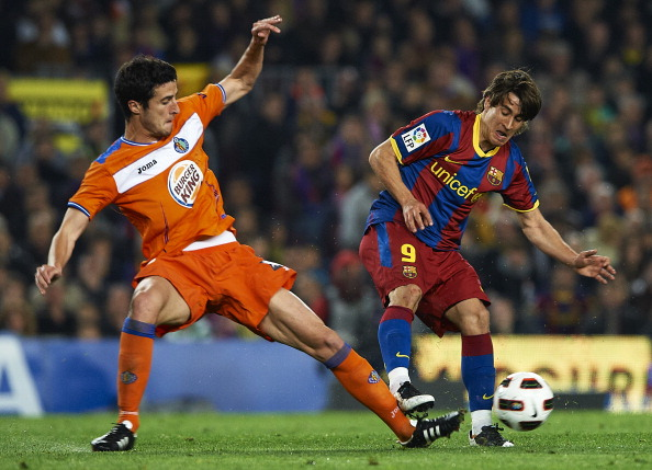 BARCELONA, SPAIN - MARCH 19:  Ivan Marcano of Getafe is tacked by Bojan Krkic (R) of Barcelona during the La Liga match between Barcelona and Getafe at Camp Nou on March 19, 2011 in Barcelona, Spain.  (Photo by Manuel Queimadelos Alonso/Getty Images)