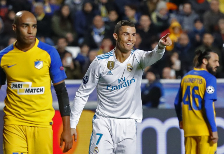 Real Madrid's Portuguese forward Cristiano Ronaldo (C) celebrates his first goal, and his team's fifth, during the UEFA Champions League Group H match between Apoel FC and Real Madrid on November 21, 2017, in the Cypriot capital Nicosia's GSP Stadium.  / AFP PHOTO / Jack GUEZ
