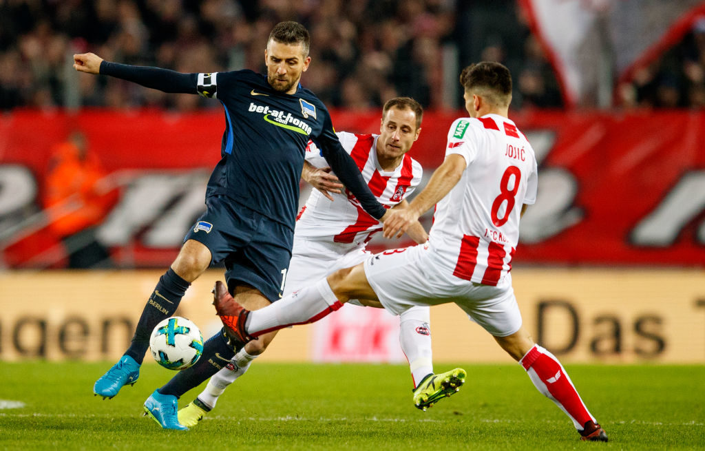 COLOGNE, GERMANY - NOVEMBER 26: Vedad Ibisevic of Berlin is challenged by Matthias Lehmann of Koeln and Milos Jojic of Koeln during the Bundesliga match between 1. FC Koeln and Hertha BSC at RheinEnergieStadion on November 26, 2017 in Cologne, Germany.  (Photo by Lars Baron/Bongarts/Getty Images)
