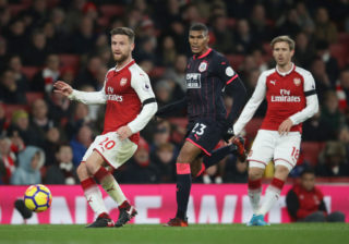 LONDON, ENGLAND - NOVEMBER 29: Shkodran Mustafi of Arsenal and Collin Quaner of Huddersfield Town watch the ball during the Premier League match between Arsenal and Huddersfield Town at Emirates Stadium on November 29, 2017 in London, England.  (Photo by Julian Finney/Getty Images)