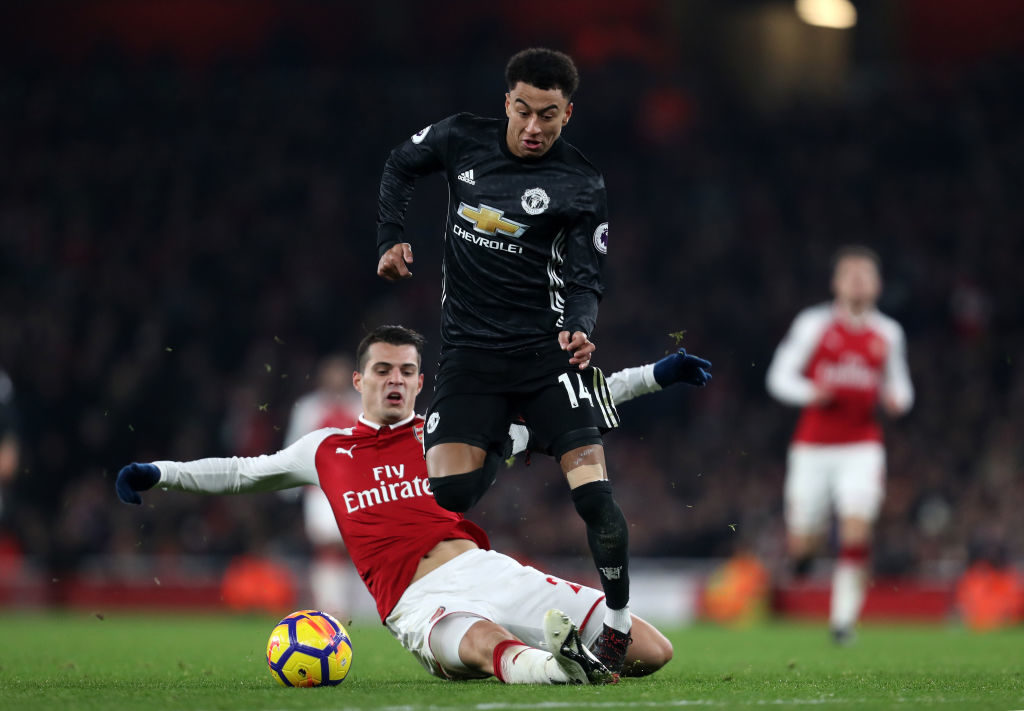 LONDON, ENGLAND - DECEMBER 02: Granit Xhaka of Arsenal and Jesse Lingard of Manchester United during the Premier League match between Arsenal and Manchester United at Emirates Stadium on December 2, 2017 in London, England. (Photo by James Baylis - AMA/Getty Images)