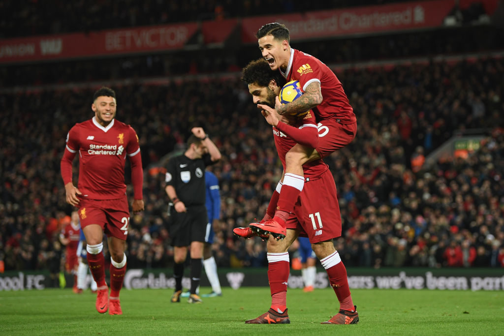 LIVERPOOL, ENGLAND - NOVEMBER 25: Mohamed Salah of Liverpool celebrates scoring his sides first goal with Philippe Coutinho of Liverpool during the Premier League match between Liverpool and Chelsea at Anfield on November 25, 2017 in Liverpool, England.  (Photo by Shaun Botterill/Getty Images)