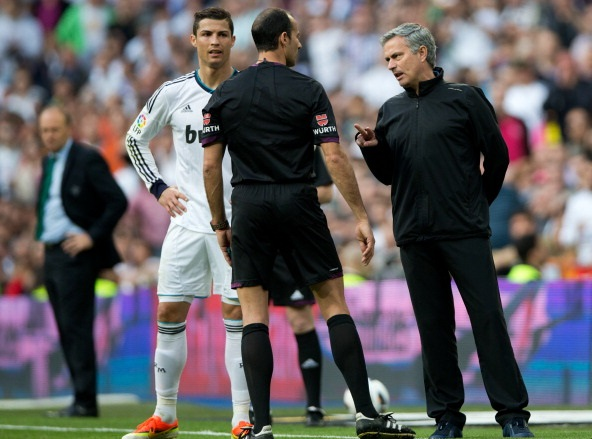 MADRID, SPAIN - APRIL 20:  Head coach Jose Mourinho (R) of Real Madrid reacts to referee     Alvarez Izquierdo as Cristiano Ronaldo looks on during the la Liga match between Real Madrid CF and Real Betis Balompie at Estadio Santiago Bernabeu on April 20, 2013 in Madrid, Spain.  (Photo by Jasper Juinen/Getty Images)