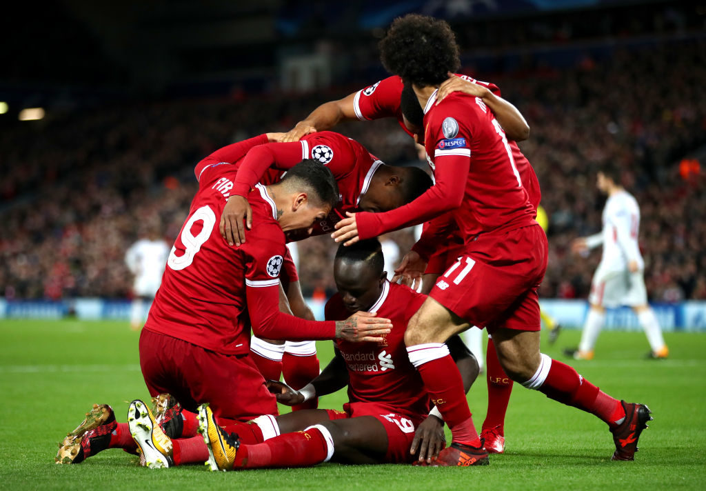 LIVERPOOL, ENGLAND - DECEMBER 06:  Sadio Mane of Liverpool celebrates scoring the 4th Liverpool goal with team mates during the UEFA Champions League group E match between Liverpool FC and Spartak Moskva at Anfield on December 6, 2017 in Liverpool, United Kingdom.  (Photo by Clive Brunskill/Getty Images)