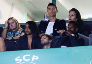 LISBON, PORTUGAL - SEPTEMBER 16:  Cristiano Ronaldo and girlfriend Georgina Rodriguez during the Primeira Liga match between Sporting CP and CD Tondela at Estadio Jose Alvalade on September 16, 2017 in Lisbon, Portugal.  (Photo by Gualter Fatia/Getty Images)