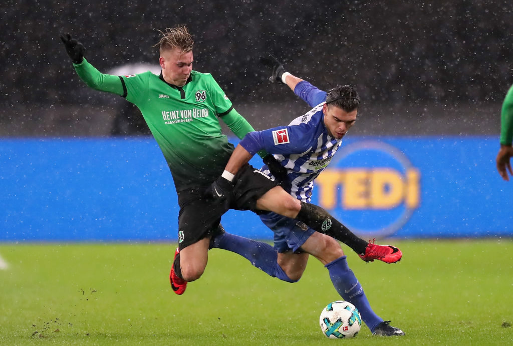xxx is challenged by yyy during the Bundesliga match between Hertha BSC and Hannover 96 at Olympiastadion on December 13, 2017 in Berlin, Germany.