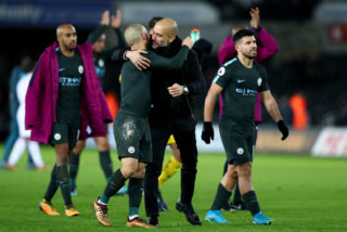 SWANSEA, WALES - DECEMBER 13: David Silva of Manchester City and Josep Guardiola, Manager of Manchester City celebrate victory after the Premier League match between Swansea City and Manchester City at Liberty Stadium on December 13, 2017 in Swansea, Wales.  (Photo by Michael Steele/Getty Images)