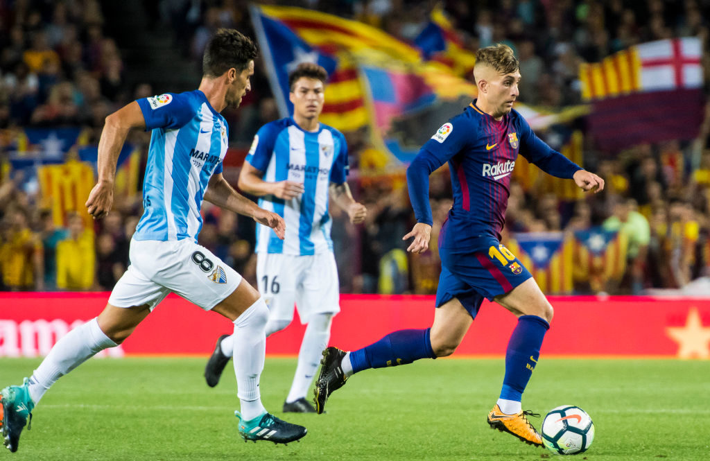 BARCELONA, SPAIN - OCTOBER 21: Gerard Deulofeu Lazaro (r) of FC Barcelona is followed by Adrian Gonzalez Morales of Malaga CF during the La Liga 2017-18 match between FC Barcelona and Malaga CF at Camp Nou on 21 October 2017 in Barcelona, Spain. (Photo by Power Sport Images/Getty Images)