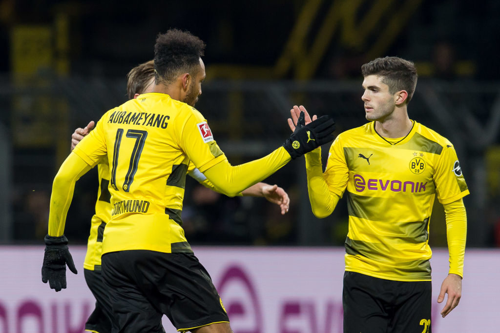 DORTMUND, GERMANY - DECEMBER 16: Pierre-Emerick Aubameyang of Dortmund shakes hands with Christian Pulisic of Dortmund during the Bundesliga match between Borussia Dortmund and TSG 1899 Hoffenheim at Signal Iduna Park on December 16, 2017 in Dortmund, Germany. (Photo by TF-Images/TF-Images via Getty Images)