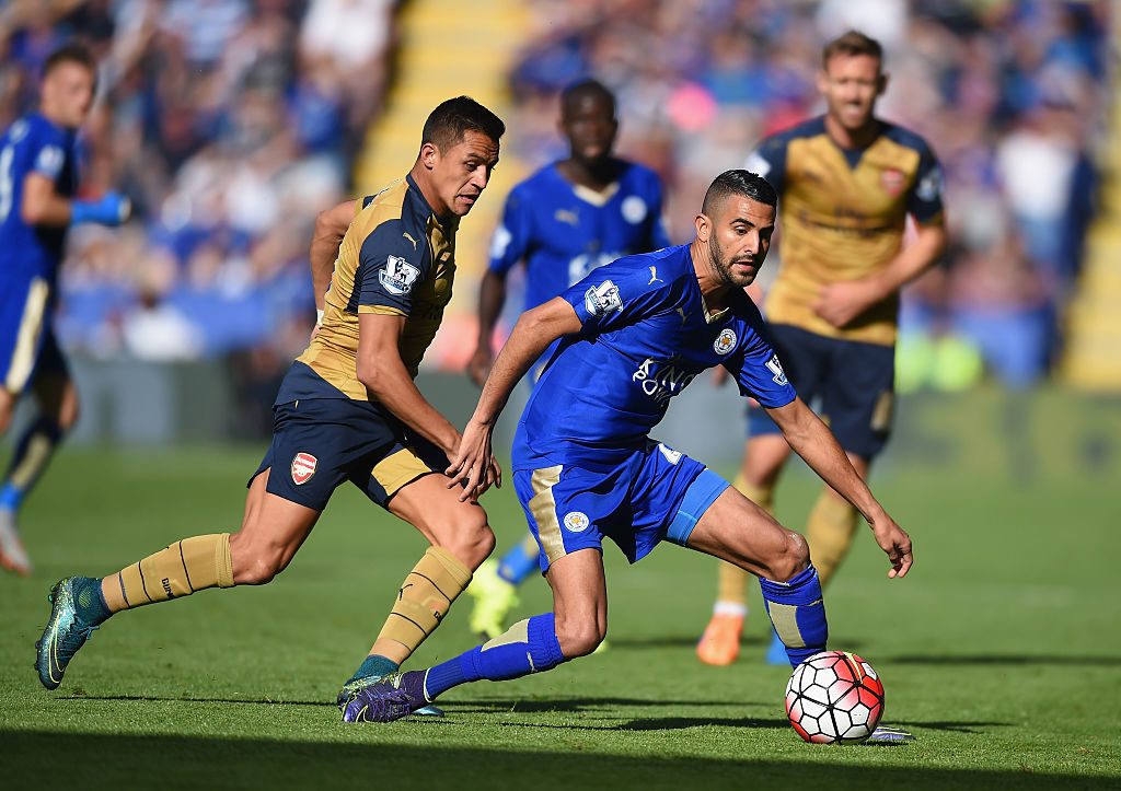 LEICESTER, ENGLAND - SEPTEMBER 26: Riyad Mahrez of Leicester City and Alexis Sanchez of Arsenal compete for the ball during the Barclays Premier League match between Leicester City and Arsenal at The King Power Stadium on September 26, 2015 in Leicester, United Kingdom.  (Photo by Michael Regan/Getty Images)