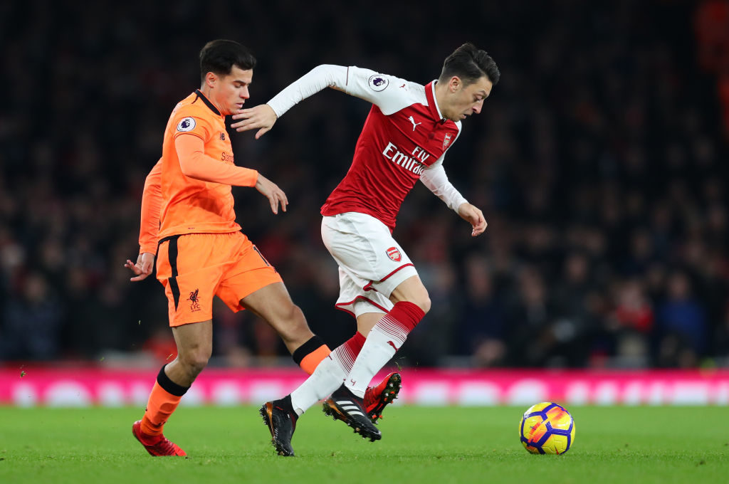 LONDON, ENGLAND - DECEMBER 22: Philippe Coutinho of Liverpool and Mesut Ozil of Arsenal during the Premier League match between Arsenal and Liverpool at Emirates Stadium on December 22, 2017 in London, England. (Photo by Catherine Ivill/Getty Images)