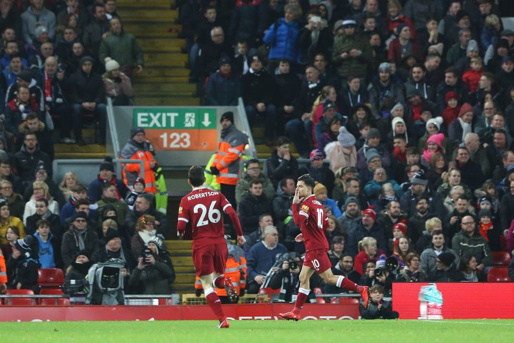 LIVERPOOL, ENGLAND - DECEMBER 26: Philippe Coutinho of Liverpool celebrates scoring his sides first goal of the match in front of the silenced Swansea fans during the Premier League match between Liverpool and Swansea City at Anfield on December 26, 2017 in Liverpool, England. (Photo by Athena Pictures/Getty Images)