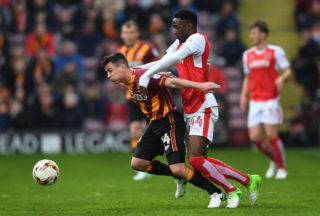 BRADFORD, ENGLAND - MAY 04:  Josh Cullen of Bradford City holds off Devante Cole of Fleetwood Town during the Sky Bet League One playoff semi final, first leg match between Bradford City and Fleetwood Town at the Northern Commercials Stadium, Valley Parade on May 4, 2017 in Bradford, England.  (Photo by Laurence Griffiths/Getty Images)