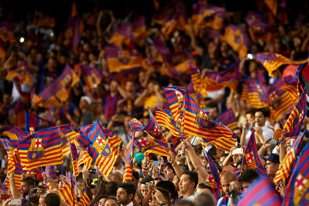 BARCELONA, SPAIN - AUGUST 13:  Barcelona fans suport their team during a warm up prior to the Supercopa de Espana Supercopa Final 1st Leg match between FC Barcelona and Real Madrid at Camp Nou on August 13, 2017 in Barcelona, Spain.  (Photo by Manuel Queimadelos Alonso/Getty Images,)